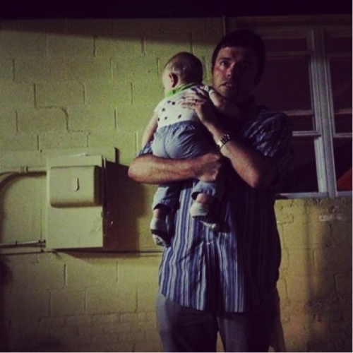 Scott and a frightened baby.